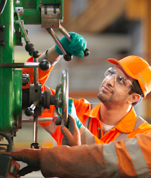 Man operating green machinery