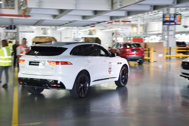 Jaguar driving inside factory