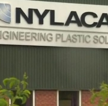 Nylacast building sign